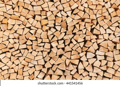Stacked pieces of wood for background or texture; Woodpile; Wood processing; Storage of fire wood; Heat generation