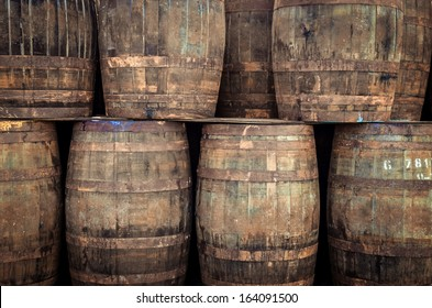 Stacked pile of old whisky barrels
