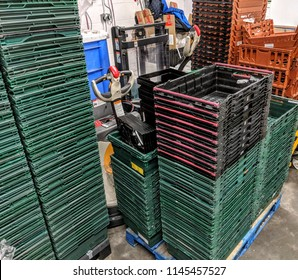 Stacked plastic baskets in warehouse