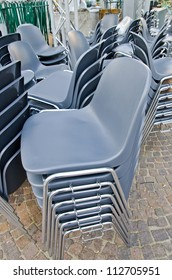 Stacked plastic chairs