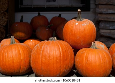 Stacked pumpkins for sale.