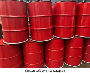 Stacked RED 55 gallon Barrels