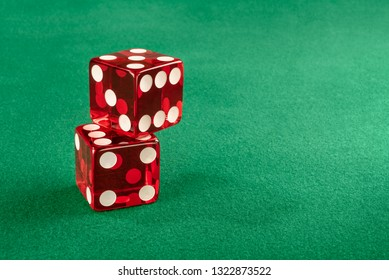 Stacked red dice in gambling table Left positioned so you can use text on the side