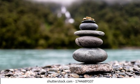Stacked Rocks in front of Waterfall