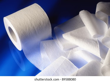 stacked rolls of toilet paper on sky blue background