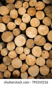 stacked round loggs of fire wood texture background