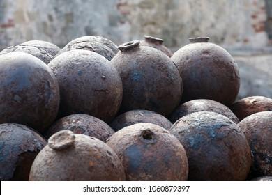 stacked rusty cannonballs forming interesting pattern, Castillo San Cristobal, San Juan, Puerto Rico, Caribbean