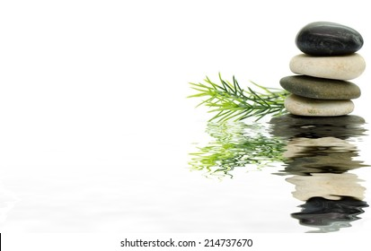 Stacked stone on white background with rosemary : Digital compositing with colour tone, water reflection and ripple effects