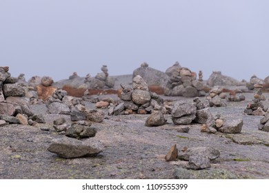 Stacked stones hikers tradition grey landscape