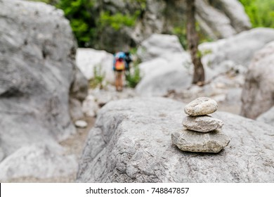 Stacked stones marked a hiking trail in nature, backpacking concept
