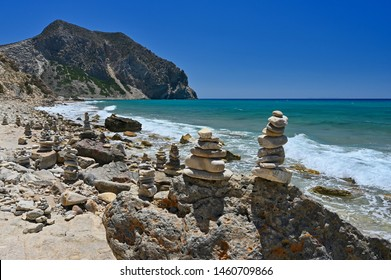 Stacked stones on the beach. Beautiful Paradise beach in Greece island Kos - Kefalos. Summer concept for vacation/holiday. Natural colorful background.
