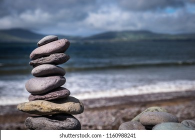 Stacked stones on the beach of Waterville, in the South West of Ireland