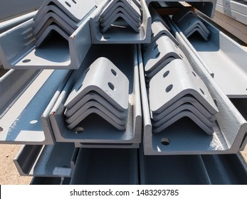 Stacked t-beams and other metal parts of a pre-fabricated building. Fast-built camp construction parts at the warehouse