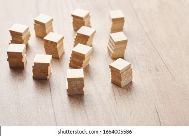Stacked in towers wood blocks on wooden table with copy space. Team and leadership concept