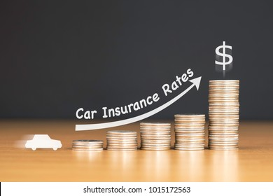 STACKED US QUARTER COINS ON WOODEN TABLE WITH WHITE ILLUSTRATION SHOWS INCREASING IN CAR INSURANCE PREMIUM RATES / FINANCIAL CONCEPT