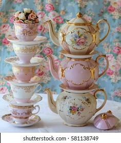 stacked vintage pink  teapots and teacups - high tea party