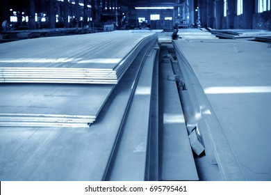 Stacked in the warehouse of the steel plate, blue tone map.