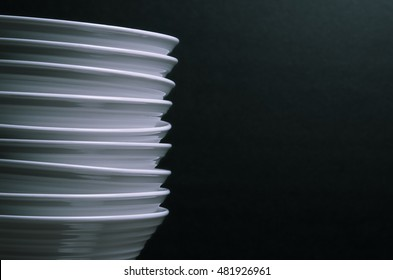 Stacked white bowls on black
