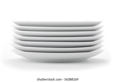 Stacked white dishes on seamless white background.