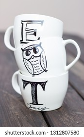 Stacked white mugs with sharpie drawing personalised gift ideas
