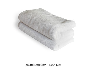 Stacked white spa cloth beach towels isolated on white background. This has clipping path.