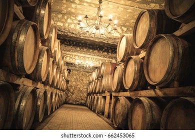 Stacked wine barrels in the old cellar of the winery