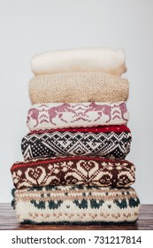 Stacked winter-themed sweaters