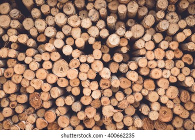 Stacked of wood log  for construction buildings background and texture