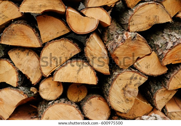 Stacked wooden logs ready for burning or cutting