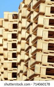 stacked wooden pallet under blue sky