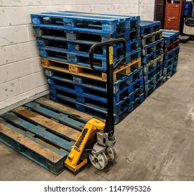Stacked wooden pallets in warehouse