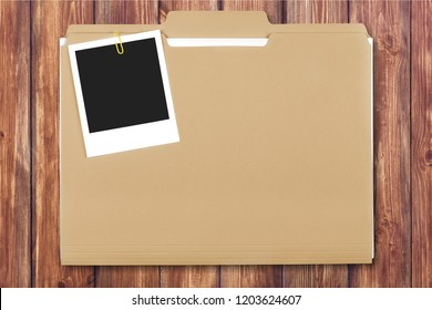 Stacked yellow file folders on wooden background