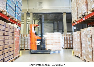 stacker loader moving goods in a wholesale and retail warehouse