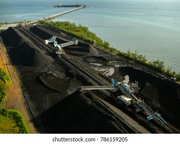 Stacker and reclaimer at coal stockpile