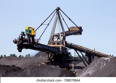 Stacker-reclaimer in a coal handling terminal.