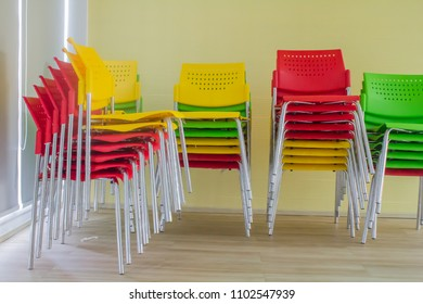 Stacking of colorful conference chair prepare to use.