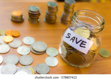 stacking gold coins with green bokeh background ,Business Finance and Money concept