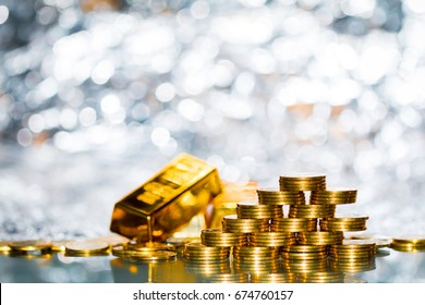 Stacking gold coins with increase on the beautiful bokeh and gold bar background, Saving money and loan for prepare in the future.