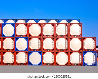 Stacking of ISO Tanks in container yard at industrial port.