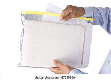 Stacking or keeping documents safely and neatly in a Transparent Plastic Zipper Bag or plastic sachet by a male person on an isolated white background .