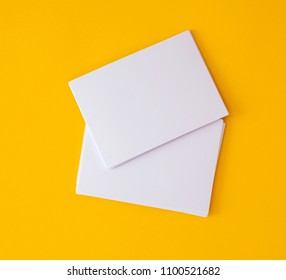 a stacking of mockup empty white business card   on vibrant yellow background , template for business  branding  design