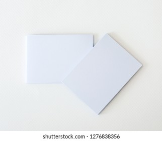 stacking of mockup empty white business card  on a white paper background , a template for business  branding identity design
