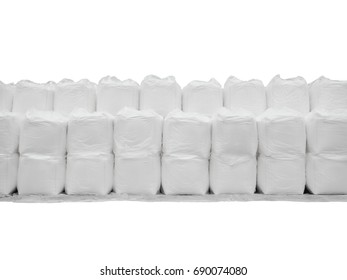 Stacking of sugar in jumbo bags isolated on white