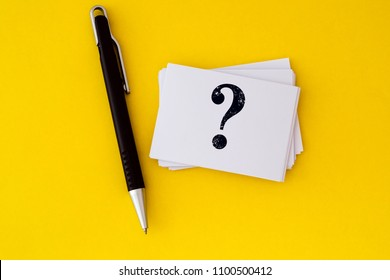 stacking of a white business card with written question mark symbol  on vibrant yellow background , Questions and Answers or Q&A concept design