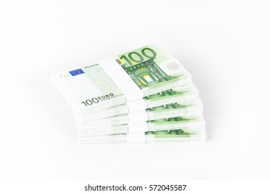 Stacks of 100 Euro Banknotes isolated on white background