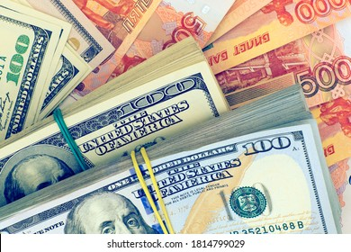 Stacks of american dollars and russian banknotes