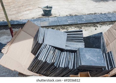 stacks of  black slate squareprepare to pave flooring of construction