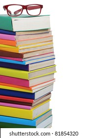 stacks of books and a glasses isolated on white background