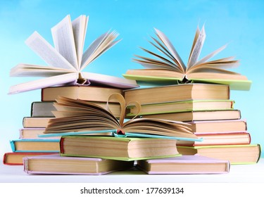 Stacks of books on table on natural background