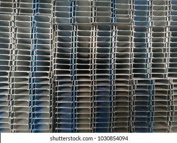 stacks of c light lip channels in a factory